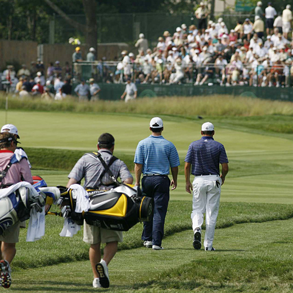 Casey, left, and Sergio Garcia made their way down the fairway.