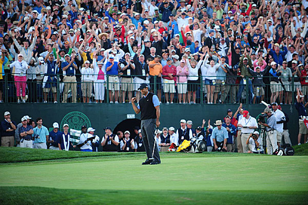 But the pain didn't stop Woods from contending. He came to the par-5 18th at one under, a shot behind Lee Westwood. He hit the green in two shots and made the eagle putt for a one-shot lead.
