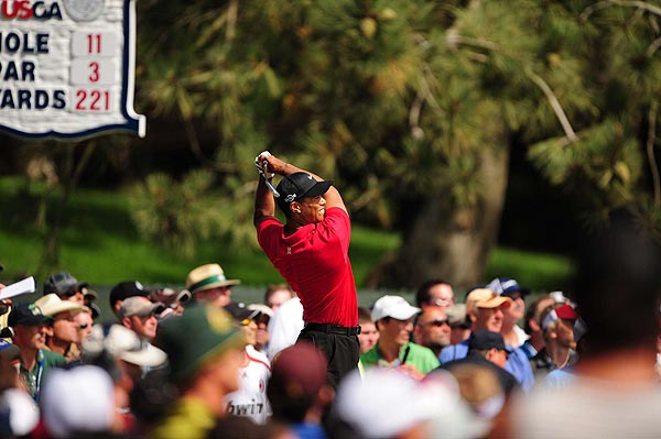 Tiger took the lead at two under par when he birdied the par-3 11th hole.
