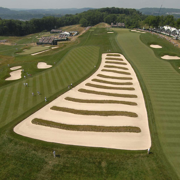 Oakmont's famous Church Pews, which separate the 3rd and 4th fairways, were among the many menacing features awaiting the players on Saturday. Only two players--Tiger Woods (69) and Steve Stricker (68)--managed to shoot under-par rounds.