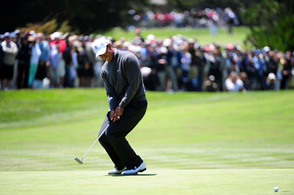 """After his round, Woods made it clear he wasn't happy about the greens at Pebble Beach. """"I played in the morning on the practice rounds and [the greens] were great,"""" Woods said. """"This afternoon they were not."""""""