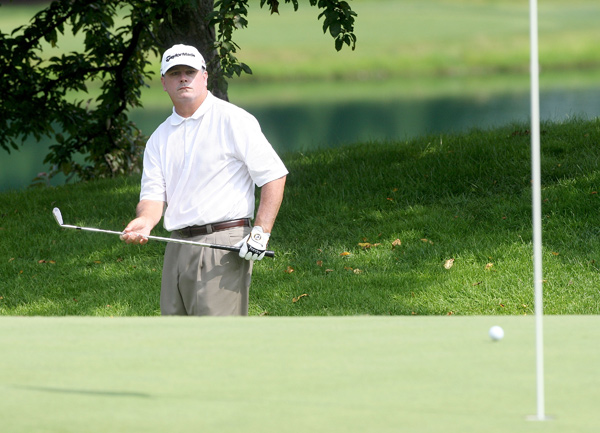Paul Goydos was at eight under when play was suspended.