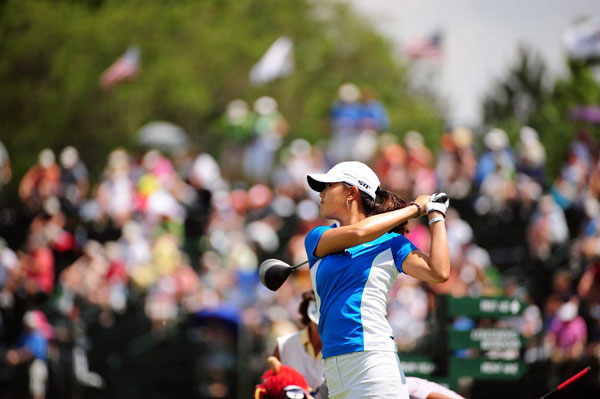 Michelle Wie will miss the cut, but she has one hole left to play on Saturday morning.