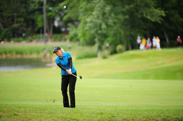 Defending champion Cristie Kerr made two double bogeys on her way to a 75.