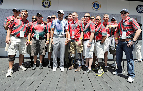 Woods took time to talk to and pose for photographs with wounded veterans.
