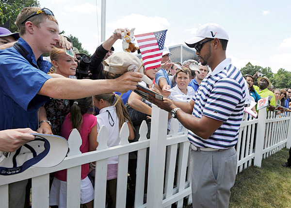 Tiger Woods was busy on Thursday at Aronimink. Though he isn't playing, Woods is the host of the tournament.