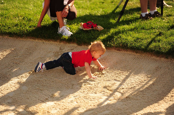 While Rose accepted the trophy from Jack Nicklaus, Rose's son played in a bunker.