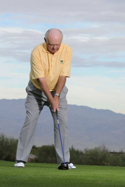 TO HIT A FADE: Step back and out with your right foot. This time, notice how the ball moves forward in your stance and points your shoulders left of the target. (You should feel your spine leaning slightly toward the target as well.) This ball position forces you to make a more descending, across-the-line blow and generate left-to-right spin. Try to swing down the left side of the fairway.