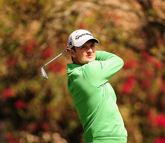 Justin Rose opened with an impressive seven-under 65. He leads by two shots over John Huh.