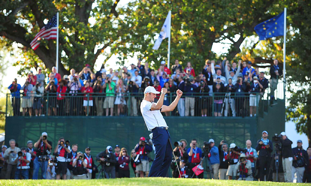 Martin Kaymer sank a six-foot par putt on the 18th hole to beat Steve Stricker, 1 up, and secure the Ryder Cup for Team Europe in one of the greatest comebacks in Ryder Cup history.