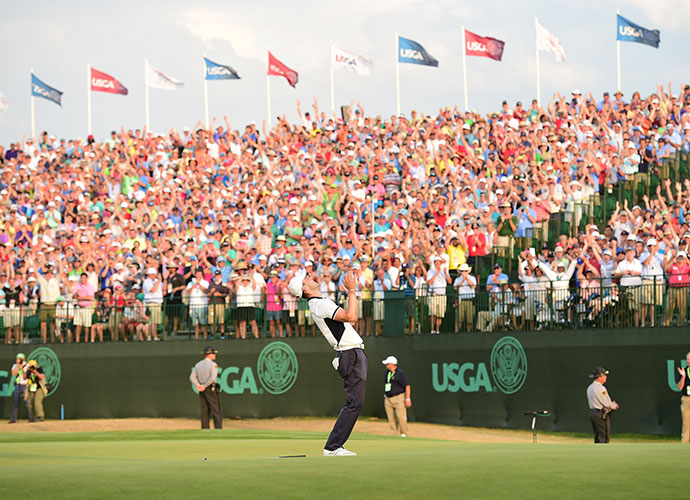 Kaymer celebrates on the 18th green after making his final putt.