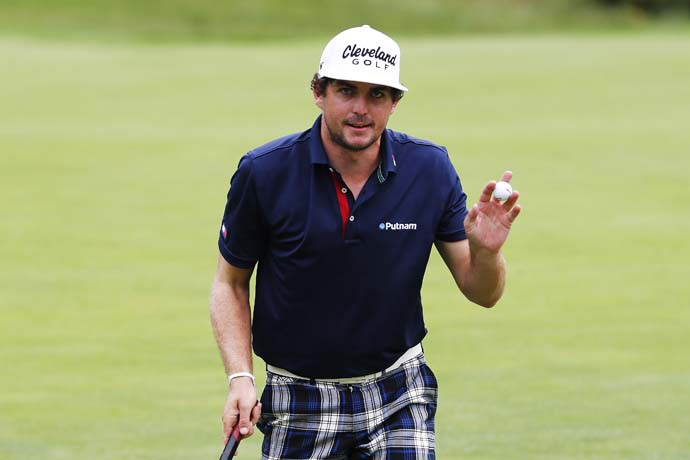 Keegan Bradley waves to fans on the ninth green Saturday. A Massachusetts native, Bradley is a fan favorite at this event.