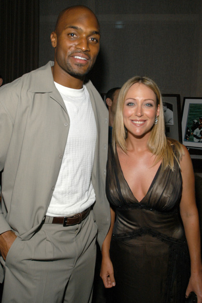 Amani Toomer of the New York Giants and Kerr at the Esquire Apartment  in New York City.