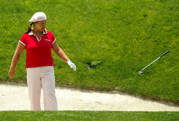 Christina Kim tossed her wedge out of a bunker at the 2005 Corona Morelia Championship.