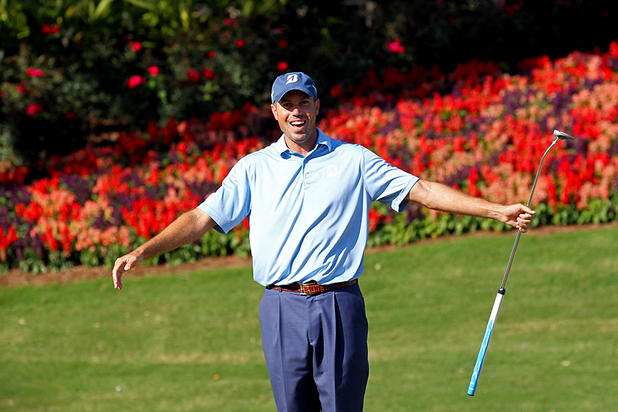 Matt Kuchar shot a four-under 68 to grab a share of the lead with Zach Johnson and Kevin Na.
