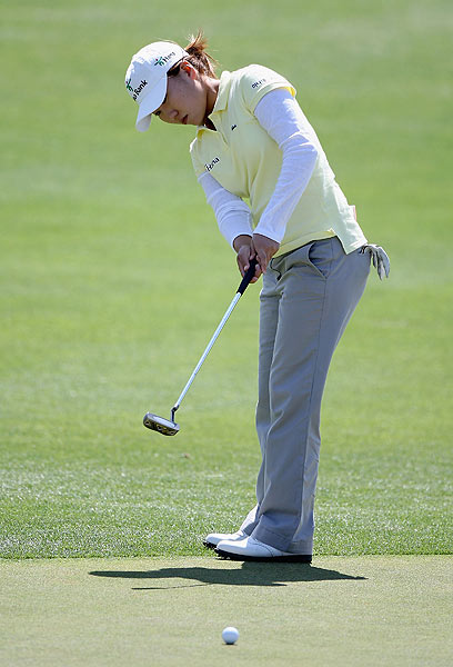 In-Kyung Kim eagled the final hole for a 4-under 68 and the early lead.