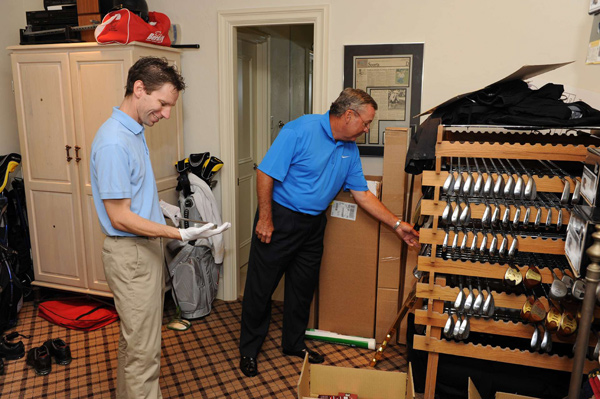 Mark Cubbedge, left, chief artifact finder for the World Golf Hall of Fame, in Wadkins' golf room.