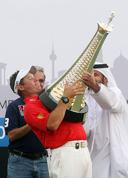 Lee Westwood could barely hold on to the Harry Vardon trophy after winning the Dubai World Championship and Race to Dubai money title. Check out more great pictures of Westwood's win.