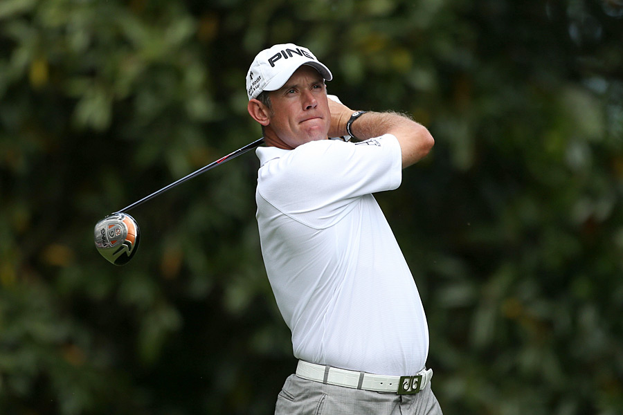 Lee Westwood leads Louis Oosthuizen by one stroke after a five-under 67.
