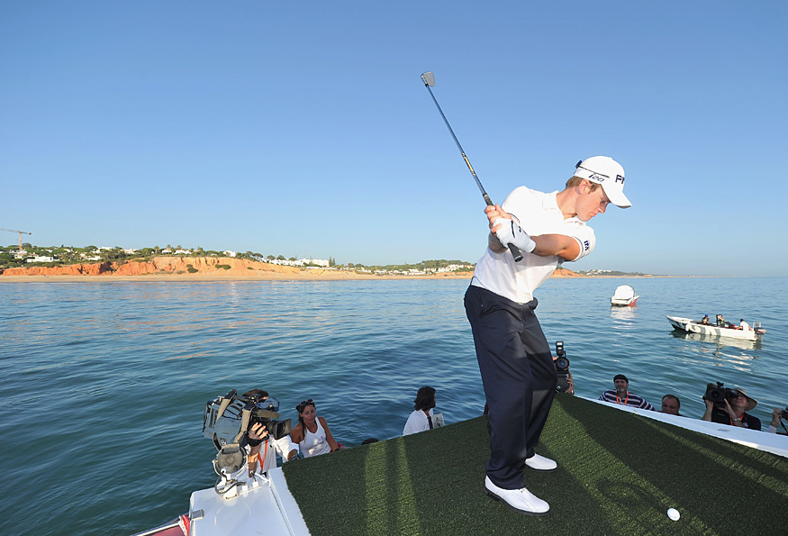 Defending champion Tom Lewis played a shot from a boat to a target on another small boat at the Portugal Masters.