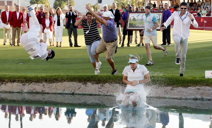 Thompson celebrated her first major at the Kraft by the traditional leap into Poppy's Pond.