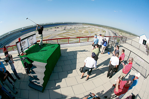 The contest comprised three events, including a a long-drive competition from a tee box platform located atop the 10-story Lone Star Tower condominium overlooking Turn 2 at the Texas Motor Speedway.