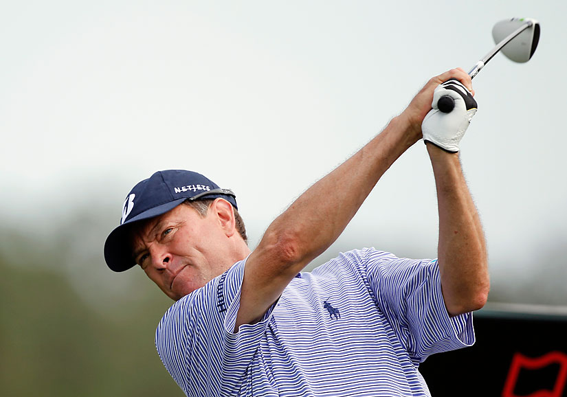 Davis Love III tied the course record with a six-under 64. Love's round included an ace at the par-3 fifth hole.
