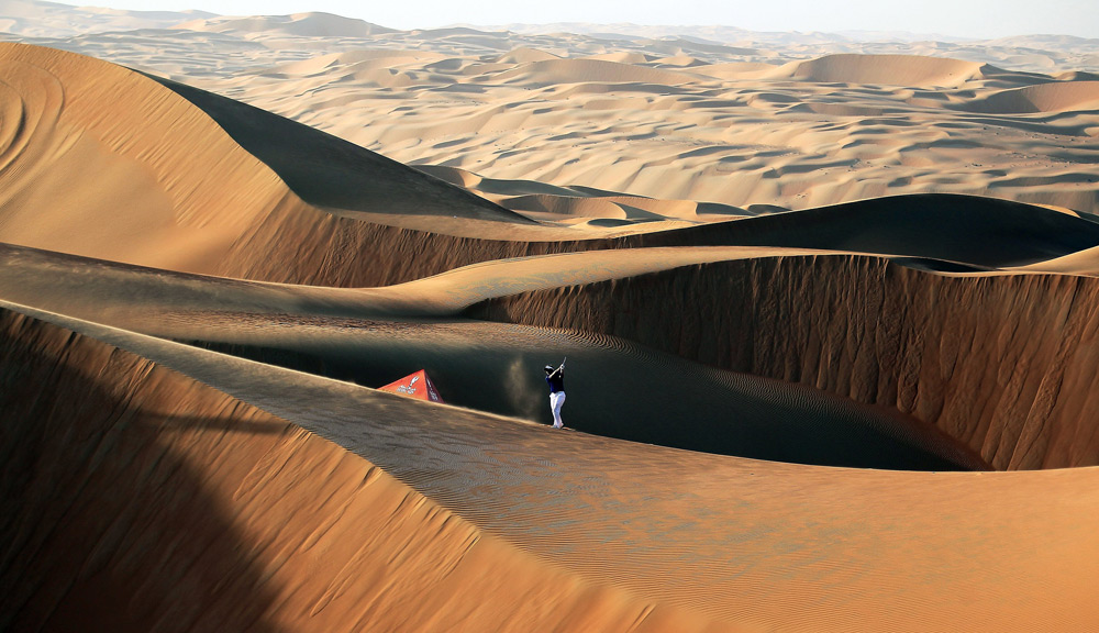 Luke Donald hit some shots among the 250-foot-high sand dunes in Abu Dhabi's Liwa Desert before the start of the Abu Dhabi HSBC Golf Championship.