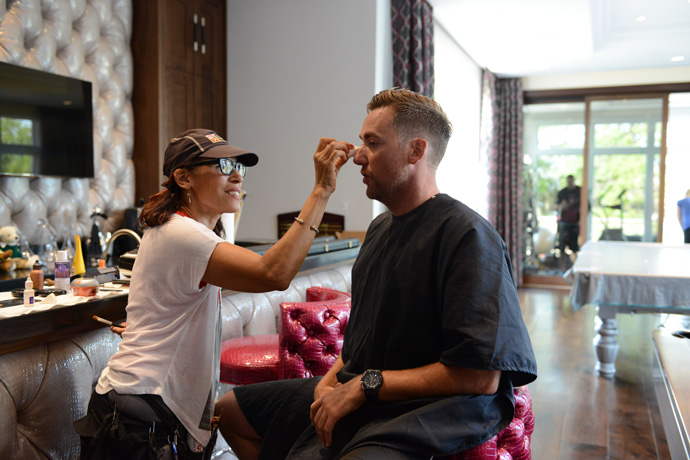 Before a photo shoot with Sports Illustrated, Poulter bantered with hair-and-makeup stylist Yolando Winters.