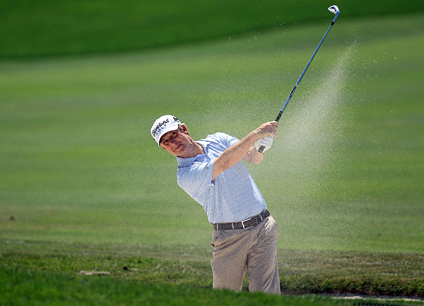 David Toms made a charge with birdies on the fourth and fifth holes, but doubled the eighth.
