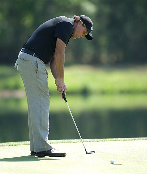 Phil Mickelson shot a two-under 70 despite making a double bogey on the par-3 7th.