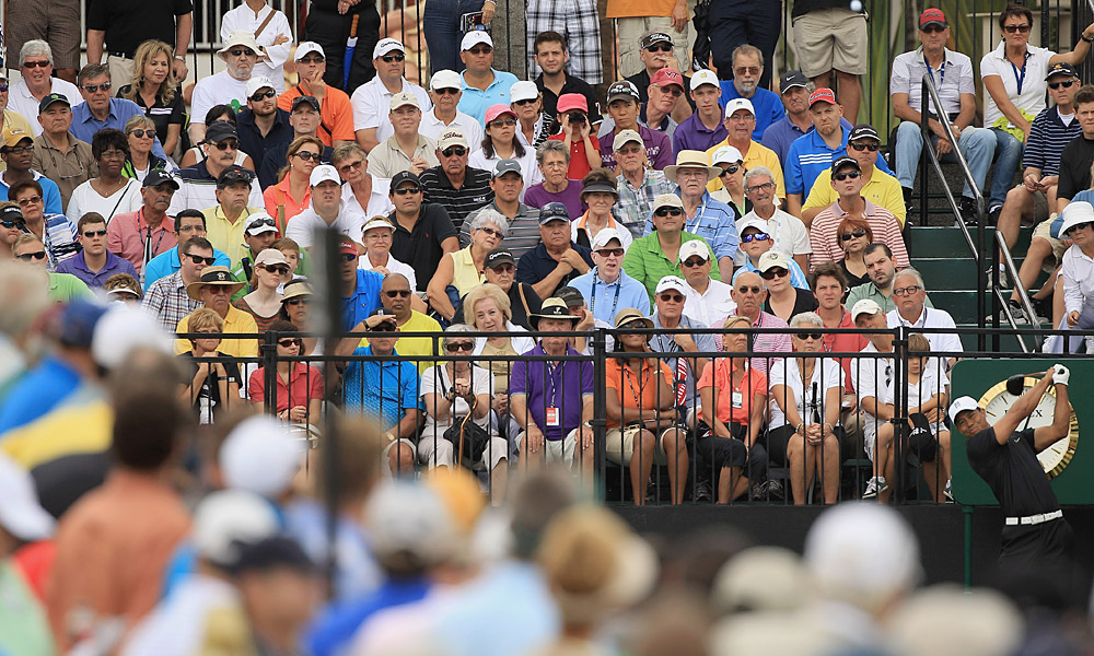 Tiger Woods made bogey at 18 to finish with a first-round 72 at the WGC-Cadillac Championship.