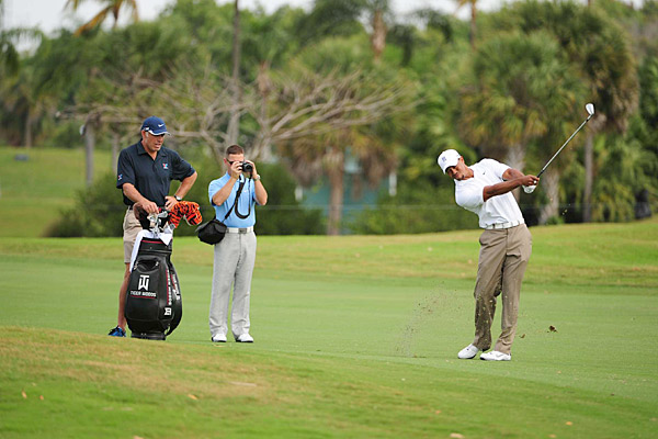 Foley followed Woods during the round, taping his shots and offering feedback.