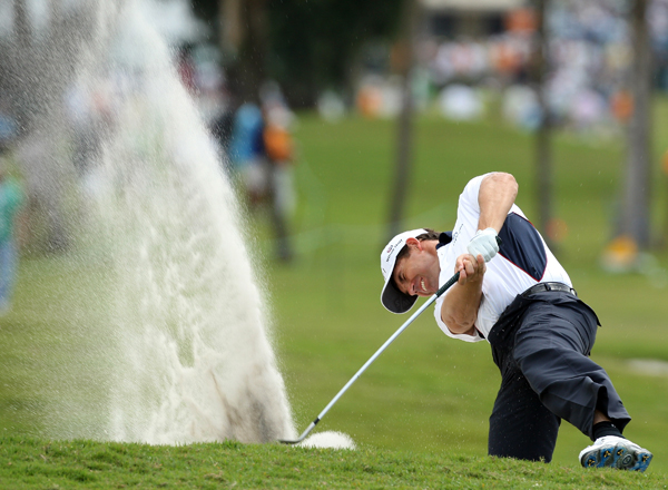 Padraig Harrington hacked out of a plugged lie on the first hole and made par. He finished with a 1-under 71.