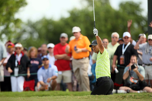 Woods holed a bunker shot on 16 for birdie.