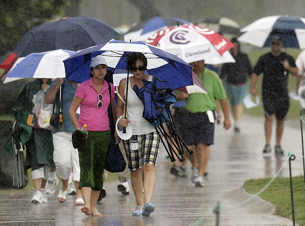 Spectators searched for cover after thunderstorms halted play on Saturday.