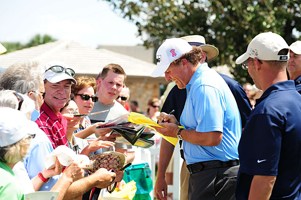 Mickelson stopped to sign a few autographs after his round.