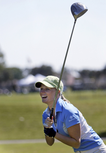 Sara Holmes, wife of J.B. Holmes, didn't hit the ball quite as far as her husband.