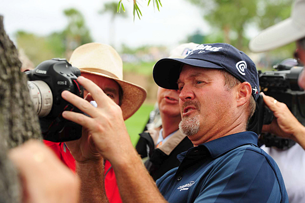 On the sixth hole, Kelly's second shot got stuck in a tree. But thanks to a photographer's telephoto lense, Kelly was able to identify his ball and make a bogey.