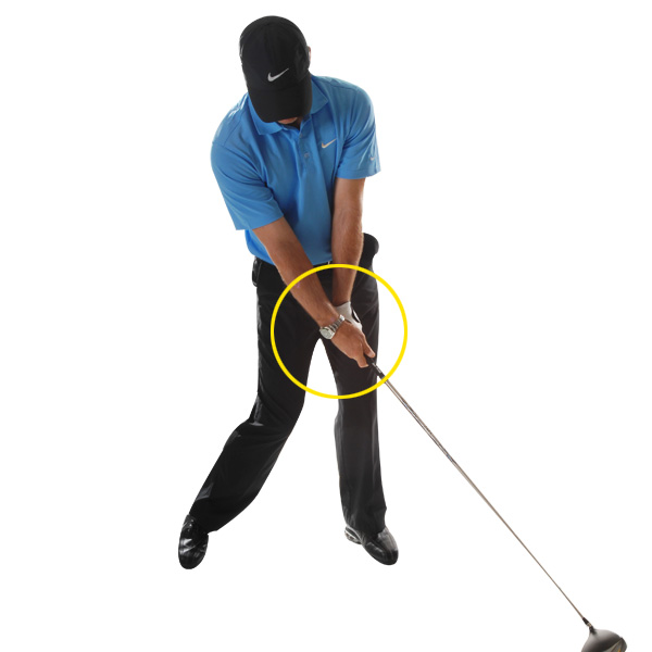 TRUST THIS!                           My toe-down position at the top means I have to really go after it at the bottom. This may sound like a compensating move, but it's actually the easiest way to square the face and swing with speed. I like to feel the clubhead passing my hands through impact, not my hands trying to hold the face square.