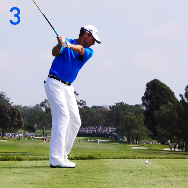3. As Davis turns into his right leg, his left wrist flattens as his right wrist bends. This motion, combined with the folding of his right arm, creates a power lever—notice the right angle formed by his left arm and the shaft—and it also helps puts the clubshaft on plane.                                                      Wrists fully set, left arm and clubshaft on same plane.