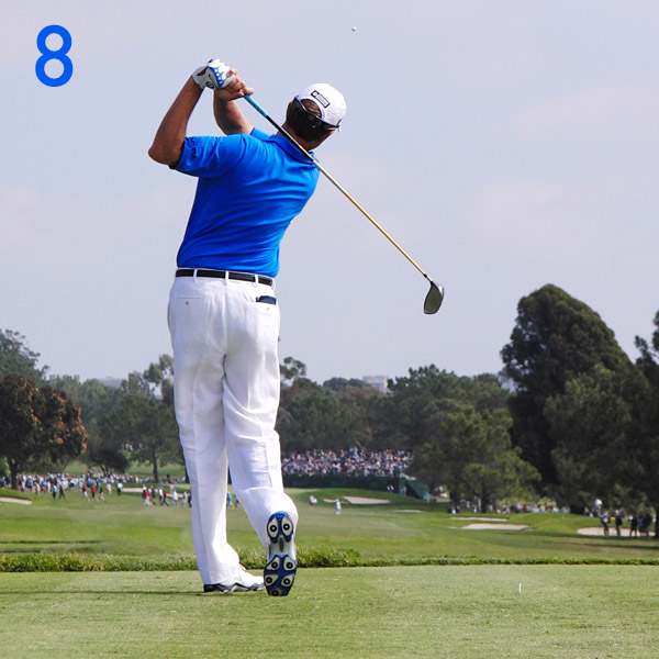 8. The matching sequence of his body, arms, hands and club is reflected by his fully balanced finish. Everything keeps going to completion—his thighs are together, his weight is on a straight left leg, and his hands are by his left ear. This is a great finish position to copy.                                                      Knees touch at the finish.