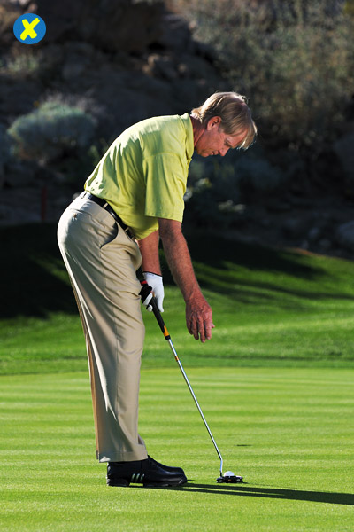 How to Stop Coming up Short                        This simple test tells you if you're standing too close and adding unwanted loft                       By Peter Krause                       Top 100 Teacher                                              This story is for you if...                                              • Your putts — even near-gimmes — often stop short of the hole.                                              • Your contact never feels solid.                                              • You're not sure how close to stand to your putter.                                              Check This!                       GET in your setup, take your right hand off the grip and let your right arm hang. If your hand hangs outside the grip, you're standing too close to the putter. This causes you to swing the putter outside and then cut across the ball. You feel this in your stroke, so you open the face, which adds loft. Now your putt has too much backspin and won't reach the hole.                       HOW TO GET IT TO THE HOLE                       Move the putter far enough away from you so that when you take your right hand off the grip it hangs even with the handle. From there, you can make a solid putting stroke that will send the ball all the way to the hole.                                              Make sure you don't overdo it! If you stand too far away from the ball (your right hand hangs inside the grip), you'll invite an overly inside-out stroke and introduce too much hand rotation (pulls) or potentially limit rotation (pushes).                       You're too close if your right hand hangs outside the grip.