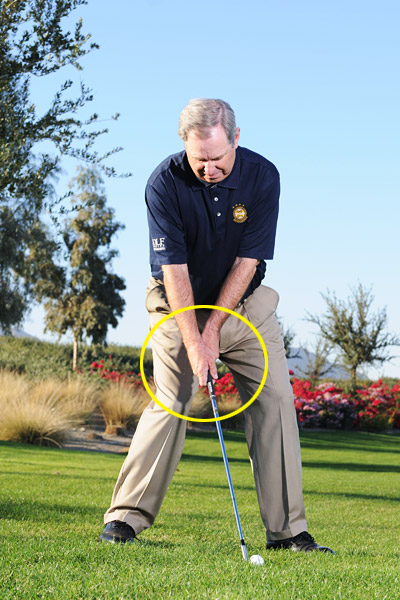How to Super-Size Your Flop                           Cup your left wrist to loft the ball high and stop it in its tracks                                                       By Mike Davis                           Top 100 Teacher                                                      This story is for you if...                                                      • You don't have a shot that flies high and stops fast.                                                      • Every time you try to hit a high lobber you end up skulling the ball.                                                      The Situation                           You've short-sided yourself and need to carry a bunker or water hazard without much room to land the ball. This isn't the time for your run-of-the-mill lob. Follow the steps on this page to get extra height and stopping power to flop this ball tight.                                                      STEP 1                           Grab your lob wedge and set up with the ball positioned between the center of your stance and your left foot, and tilt the shaft away from the target. This aggressive shaft lean adds loft to your club without requiring you to open the face, which reduces the hitting area on the clubface and makes for a more difficult shot.