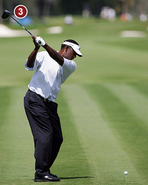 As a result, Vijay's                             hands work up                             through his right                             shoulder instead of behind                             it. This more upright swing                             creates a straight line                             between his left arm and                             the clubshaft, an alignment                             critical to great ballstriking.