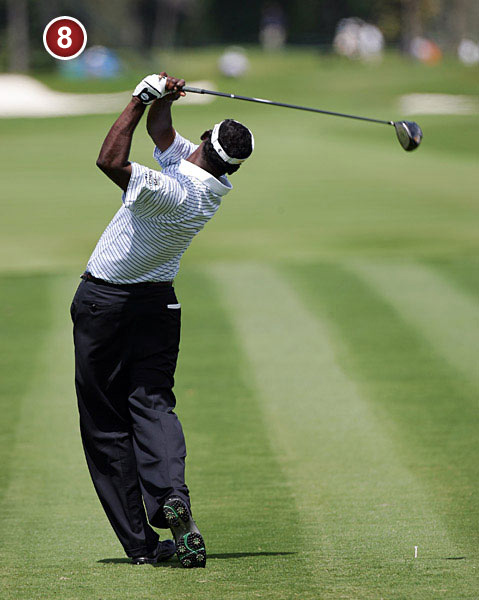 A classic fader's                           finish with his right                           side tilted toward                           the ground in the followthrough.                           This keeps Vijay's                           right side working under,                           limiting excessive roll of                           his hands that could cause                           the ball to curve to the left.