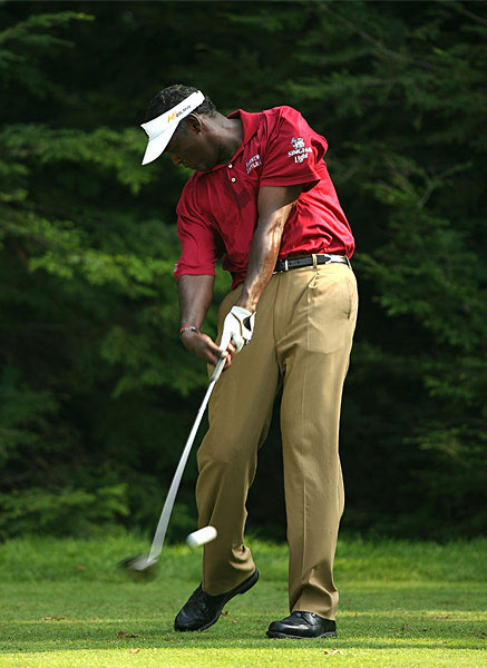 "Give Hooks the Finger                                                      Notice how only Vijay's right index finger and thumb                           remain in contact with the club after impact. This serves                           an important purpose.                                                       Letting his right hand come off                           keeps it from excessively participating in the shot, which                           could send the ball left. This is an anti-hook measure that                           Vijay shares with Phil Mickelson. This is the opposite of                           holding on or steering.                                                       Instead, Vijay fully releases the                           club to produce a ""power fade."" One technical thing to                           note: Despite the unusual position of his right hand,                           Vijay's left hand and wrist remain flat during impact.                           This is mandatory for good ballstriking."