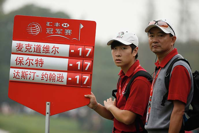 Marshals and the scoreboard during the final round of the WGC-HSBC Champions at the Sheshan International Golf Club.
