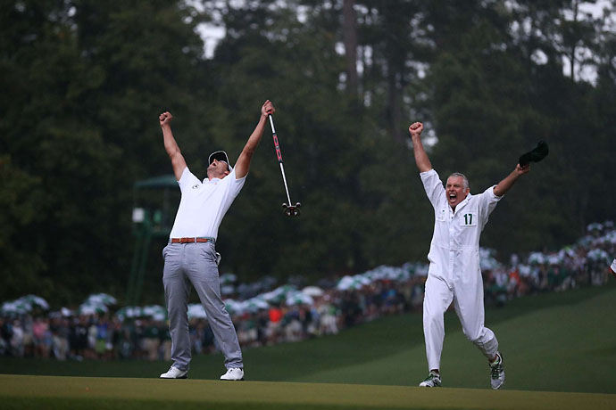 Adam Scott celebrates his playoff win at the 2013 Masters with caddie Steve Williams.