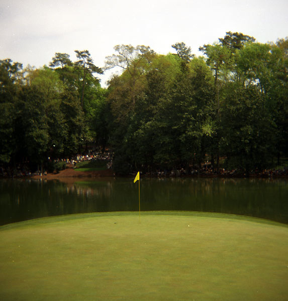 """I couldn't pick just one shot. I                           love this one — it was taken                           during the par-3 contest.                           Despite the galleries in the                           background, the flag                           actually looks lonely, and                           the symmetry is wonderful.                           It really shows the essential                           simplicity of Augusta — or                           of any other golf course,                           for that matter.""                                                      — Robert Beck for Sports Illustrated"